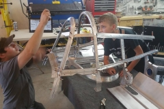 Youths Alex and Matt working on the rear gunner canopy
