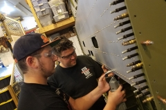 Founder Patrick Mihalek teaching youth Keagan how to squeeze rivets